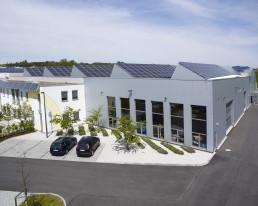 Modern building with roof-mounted photovoltaic installation