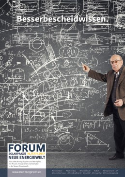 Professor on a large blackboard full of formulas